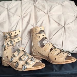 Belted cut-out peep toe flat sandals from Italy